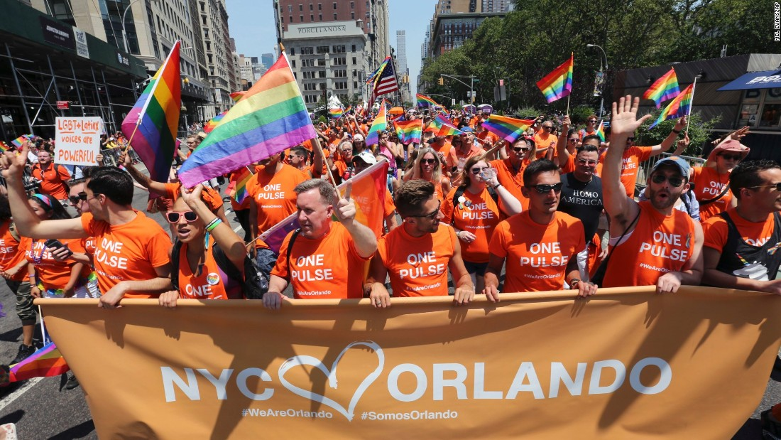 Participants walk along along Fifth Avenue during the New York City Pride Parade on June 26.