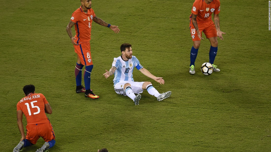 Argentina's Lionel Messi gestures surrounded by Chile's Jean Beausejour, left, Chile's Arturo Vidal and Chile's Gonzalo Jara, right.