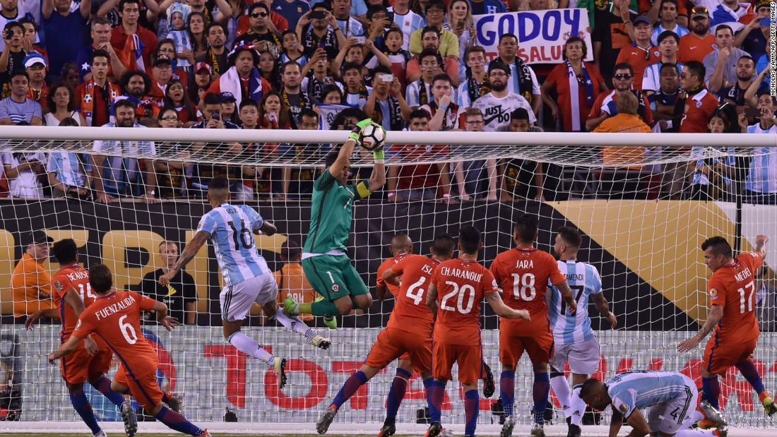 Chile's goalkeeper Claudio Bravo catches the ball.