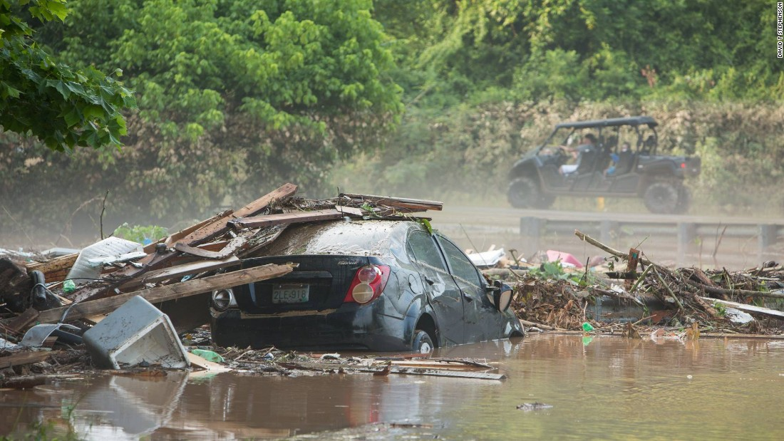 A car sits in floodwaters in Jordan Creek, West Virginia, on June 26.