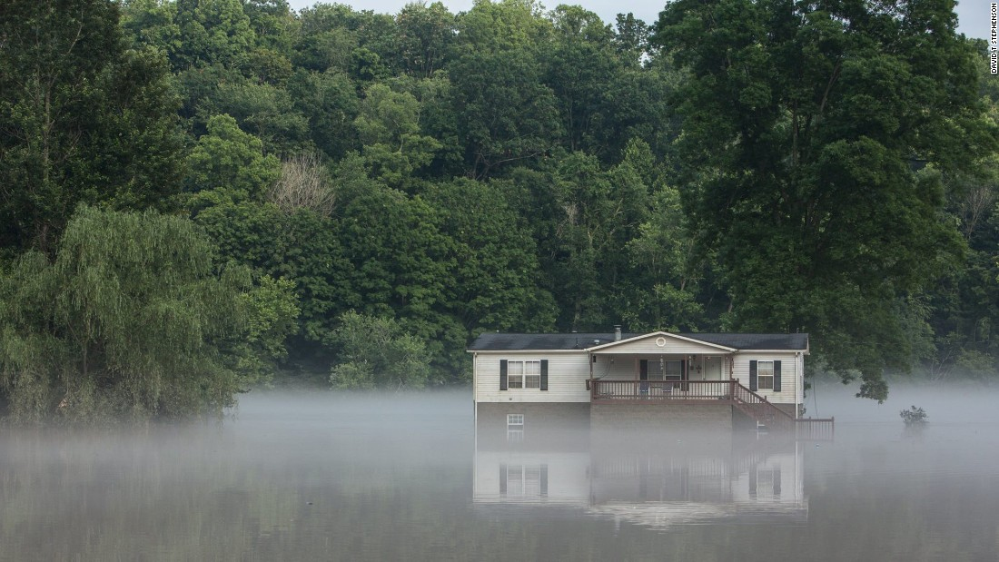 Water surrounds a house in Clendenin, West Virginia, on June 26.