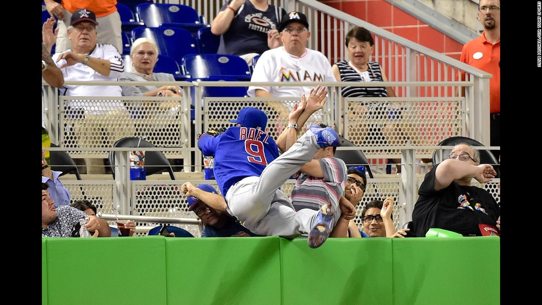 Javier Baez, third baseman for the Chicago Cubs, makes a diving catch in foul territory during a game in Miami on Friday, June 24.