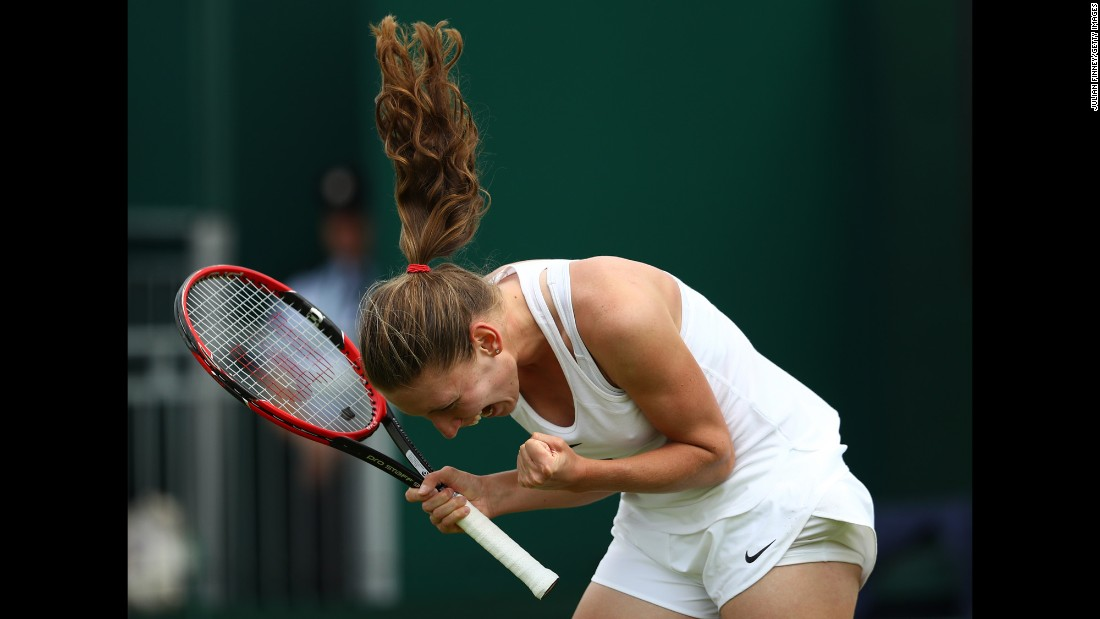 Ekaterina Alexandrova celebrates her first-round Wimbledon victory over Ana Ivanovic on Monday, June 27. It was her first match ever in the main draw of a Grand Slam.