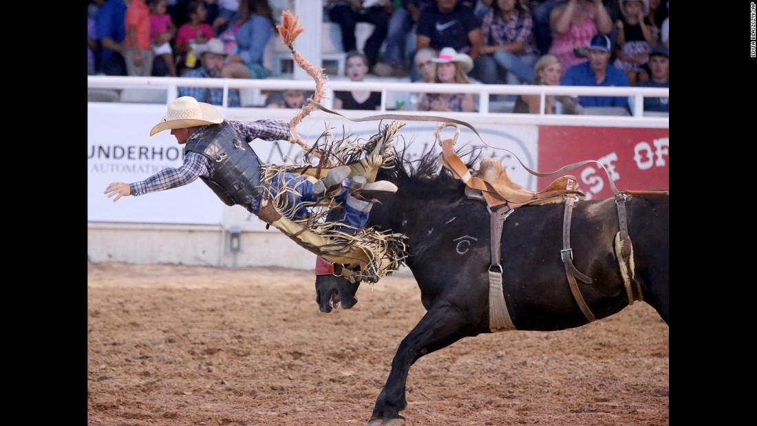 Brewster Guin gets bucked off Social Call during the West of the Pecos Rodeo in Pecos, Texas, on Thursday, June 23.
