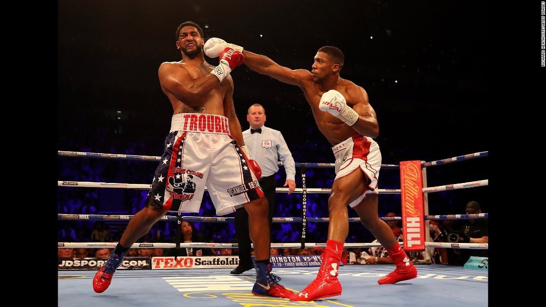 "Anthony Joshua punches Dominic Breazeale during their heavyweight title bout in London on Saturday, June 25. Joshua knocked out Breazeale in the seventh round to retain the IBF title. <a href=""http://www.cnn.com/2016/06/21/sport/gallery/what-a-shot-sports-0621/index.html"" target=""_blank"">See 28 amazing sports photos from last week</a>"