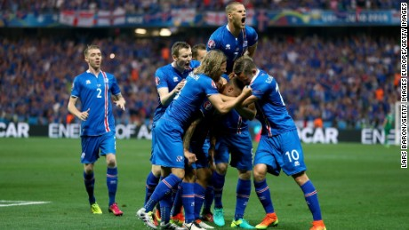 NICE, FRANCE - JUNE 27:  Ragnar Sigurdsson (C, obscured) of Iceland celebrates scoring his team's first goal with his team mates during the UEFA EURO 2016 round of 16 match between England and Iceland at Allianz Riviera Stadium on June 27, 2016 in Nice, France.  (Photo by Lars Baron/Getty Images)