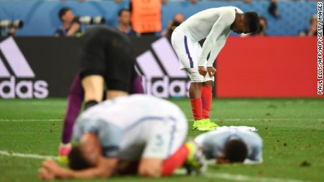 TOPSHOT - England's forward Daniel Sturridge (back) and England's defender Gary Cahill reacts after loosing 1-2 to Iceland in the Euro 2016 round of 16 football match between England and Iceland at the Allianz Riviera stadium in Nice on June 27, 2016.   / AFP / PAUL ELLIS        (Photo credit should read PAUL ELLIS/AFP/Getty Images)