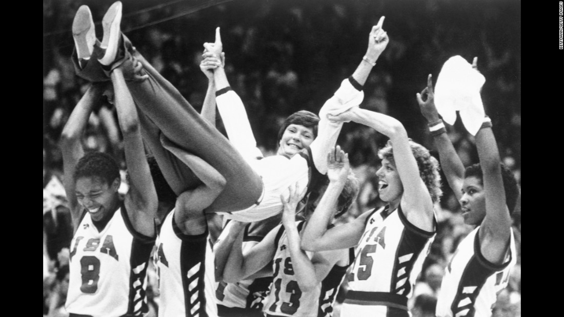 Coach Pat Summitt is carried off the floor by her players after the USA won the gold medal in basketball against Korea in the 1984 Olympics.