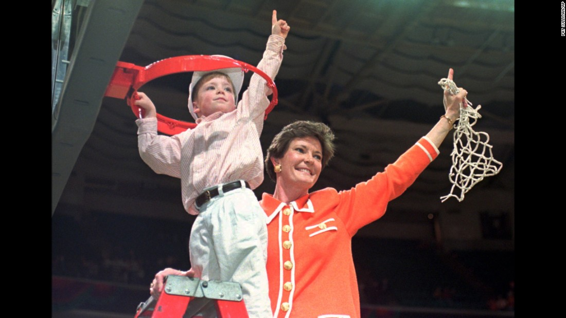 Tennessee coach Pat Summitt and son Tyler, 5, take down the net after winning the NCAA Women's Final Four against Georgia at the Charlotte Coliseum in North Carolina on March 31, 1996.