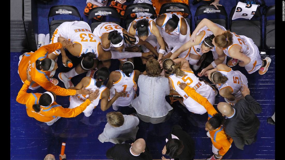 Tennessee players and head coach Pat Summitt join hands before taking the court against Kentucky in an NCAA college basketball championship game at the Southeastern Conference tournament on March 6, 2011, in Nashville.