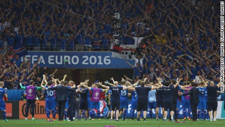 Iceland players celebrate their team's 2-1 win in front of the supporters after the UEFA EURO 2016 round of 16 match between England and Iceland at Allianz Riviera Stadium on June 27, 2016 in Nice, France.