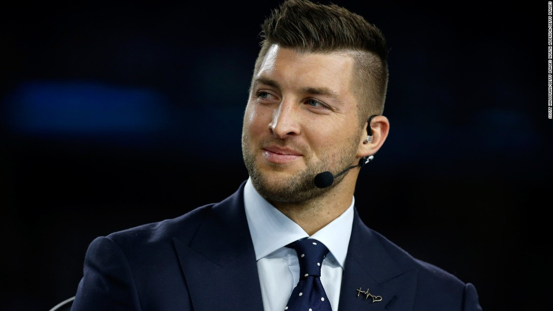 SEC Network analyst Tim Tebow speaks on air before the Goodyear Cotton Bowl on December 31, 2015, in Arlington, Texas. The 2007 Heisman Trophy winner and former NFL quarterback has been a popular and polarizing figure since his college days at the University of Florida.