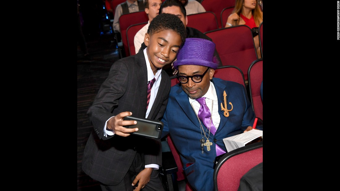 Actor Miles Brown, left, takes a photo with film director Spike Lee during the BET Awards on Sunday, June 26.