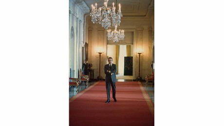 U.S. President Richard Nixon waits to enter the East Room of the White House for an event in 1974. A few weeks later, the Watergate scandal would drive him from office.