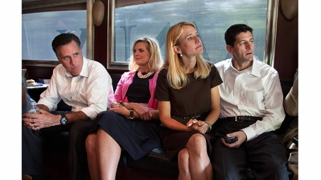 Republican presidential candidate Mitt Romney, left, and his running mate, Paul Ryan, ride a campaign bus with their wives Ann and Janna in 2012.