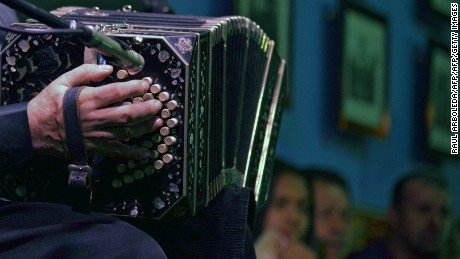 "A man plays teh bandoneon during a tribute to tango singer and composer Carlos Gardel at the ""Casa Gardeliana"" Museum in Medellin, Antioquia department, Colombia, on June 22, 2015. Next June 24th marks the 80th anniversary of Gardel's death in an air crash in Medellin, Colombia. AFP PHOTO / Raul ARBOLEDA        (Photo credit should read RAUL ARBOLEDA/AFP/Getty Images)"