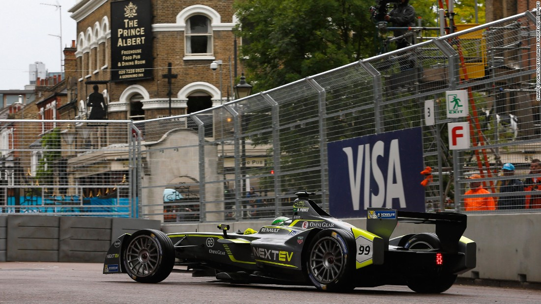 Last year's championship winner, leader Nelson Piquet of Brazil, takes his car around a corner near a pub on the borders of the Battersea circuit.