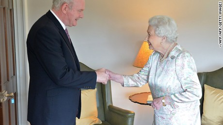 In this handout image received from the Northern ireland Office on June 27, 2016, Britain's Queen Elizabeth II shakes hands with Northern Ireland Deputy First Minister Martin McGuinness (L) at Hillsborough Castle, south of Belfast on June 27, 2016 on the start of a two day visit to the province. / AFP / Northern Ireland Office / Aaron McCracken/Harrisons 07778        (Photo credit should read AARON MCCRACKEN/HARRISONS 07778/AFP/Getty Images)