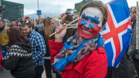 Fans of Iceland celebrate at a public screening of the UEFA Euro 2016 Round of 16 football match England v Iceland, taking place in France, on June 27, 2016 in Reykjavik, Iceland. / AFP / HALLDOR KOLBEINS        (Photo credit should read HALLDOR KOLBEINS/AFP/Getty Images)