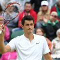 Bernard Tomic celebrates victory