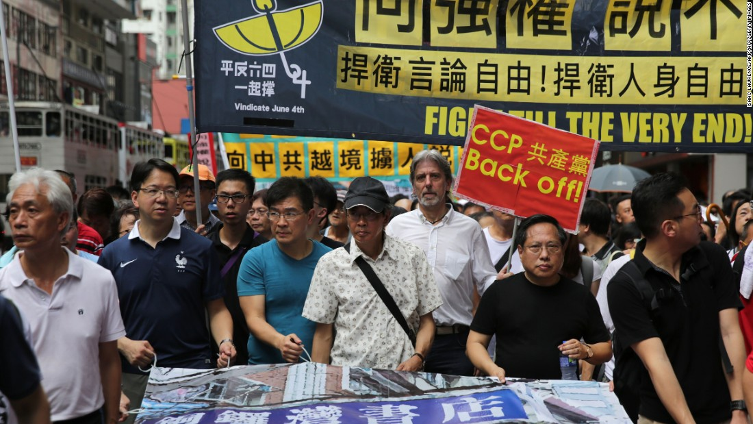 "<strong>A bookseller's return:</strong> Thousands march in support of Lam Wing-kee, who says he, along with four colleagues, was <a href=""http://cnn.com/2016/06/20/asia/china-hong-kong-bookseller-lam-wing-kee/"">kidnapped by Chinese agents</a> for publishing books critical of President Xi Jinping and other top officials. Lam's revelations spark outrage in the city, putting further strain relations with China."