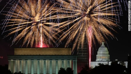 Fireworks light up the sky over the Lincoln Memorial, Washington Monument, and the U.S. Capitol.