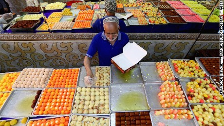 DUBAI, UNITED ARAB EMIRATES - JULY 16: A man sells sweets ahead of Eid celebrations on July 16, 2015 in Dubai, United Arab Emirates. The Muslim holiday Eid marks the end of 30 days of dawn-to-sunset fasting during the holy month of Ramadan.  (Photo by Francois Nel/Getty Images)