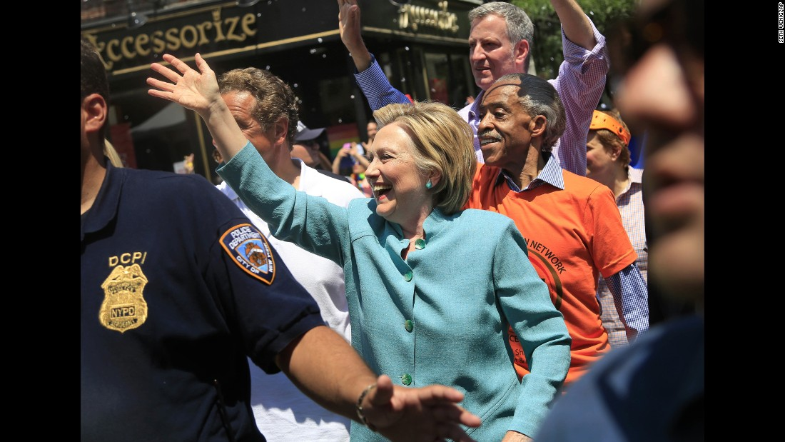 Democratic presidential candidate Hillary Clinton marches in the New York City Pride Parade along with the Rev. Al Sharpton and Mayor Bill de Blasio on Sunday, June 26.