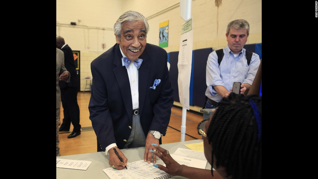 U.S. Rep. Charles Rangel looks up at reporters while voting in New York's congressional primary on Tuesday, June 28. Rangel, who has served in Congress since 1971, is not running for re-election.