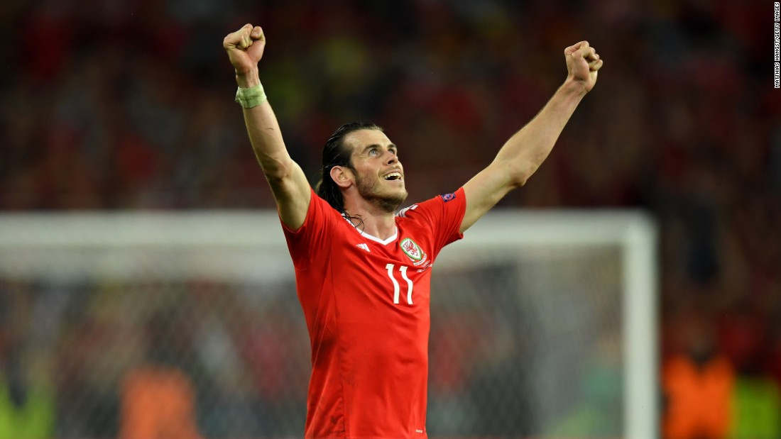 Welsh superstar Gareth Bale raises his arms in victory.