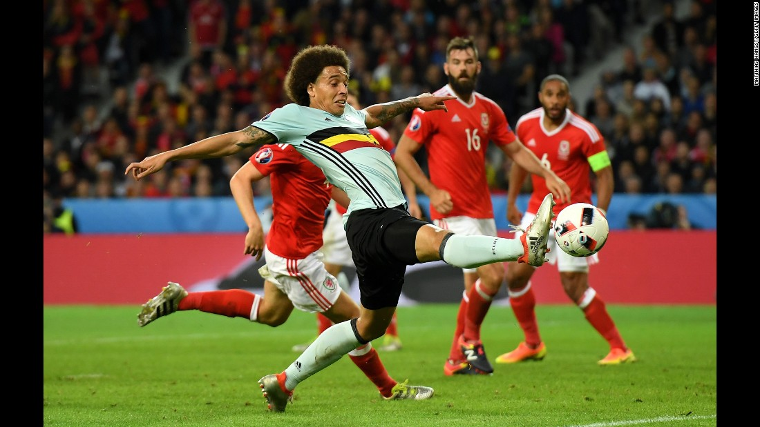 Belgian midfielder Axel Witsel stretches for the ball.