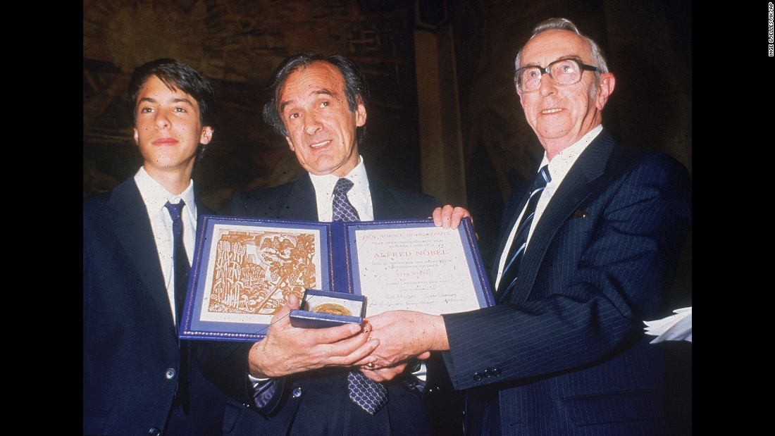 Author Elie Wiesel, center, with his son, Elisha, left, and Egil Aarvik, chairman of the Nobel committee, pose with the Nobel Prize in Oslo, Norway, on December 10, 1986.