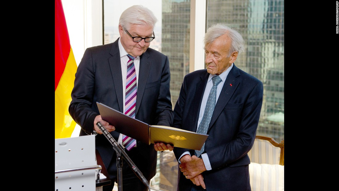German Foreign Minister Frank-Walter Steinmeier, left, presents Elie Wiesel the German Federal Cross of Merit in New York on September 23, 2014.