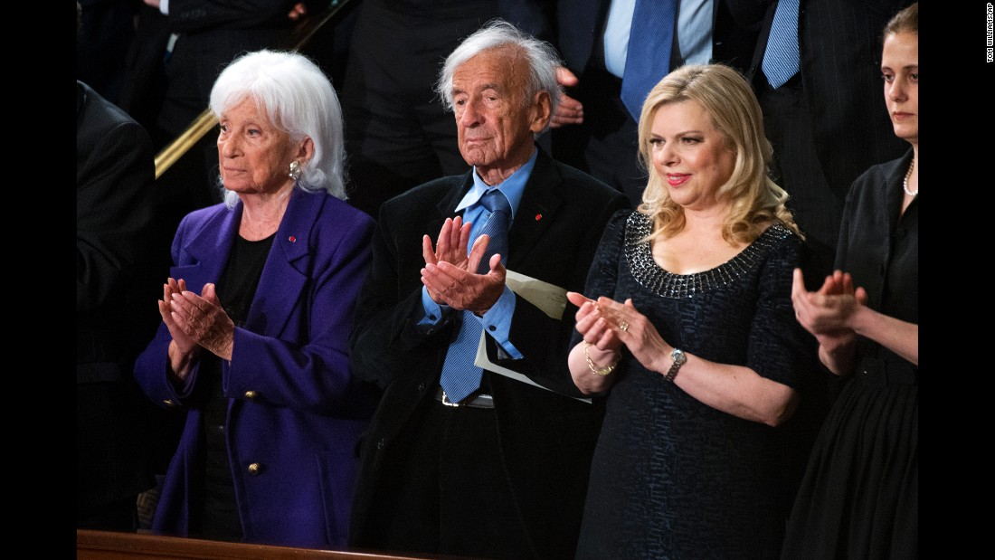 Holocaust survivor Elie Wiesel, center; his wife, Marion, left; and Sara Netanyahu, wife of Israeli Prime Minister Benjamin Netanyahu, are pictured in the U.S. House of Representatives chamber before Netanyahu's address to a joint meeting of Congress, March 3, 2015. Wiesel died Saturday, July 2, 2016, at age 87.
