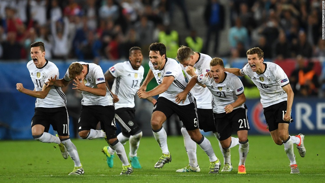 Germany players run to celebrate after Jonas Hector scored to win the game through the penalty shootout in the quarterfinal match against Italy on Saturday, July 2.