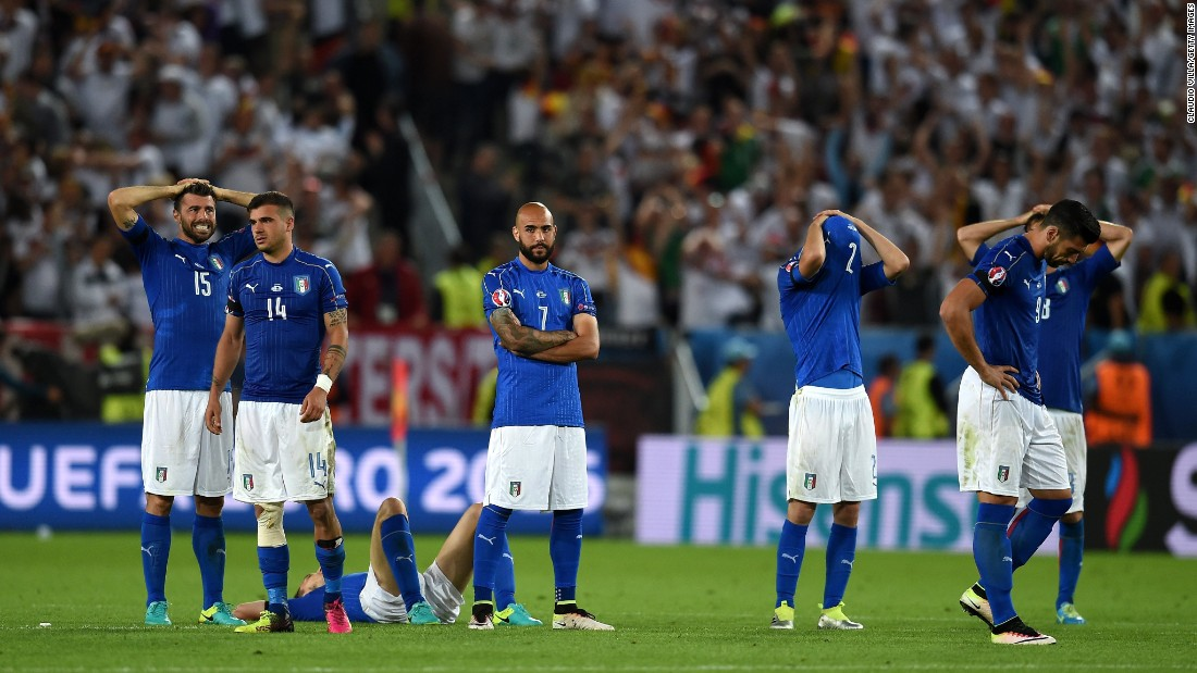 Italy players react after their defeat after the penalty shootout.