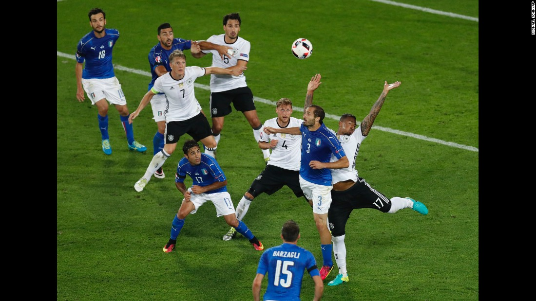 Italy's Giorgio Chiellini, right, is fouled by Germany's Jerome Boateng.