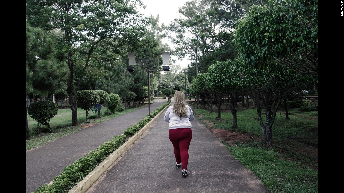 Contestant Bianca Valdez walks in a park in Asuncion. Each contestant sees a nutritionist, a psychologist and an image consultant three months before the fashion show part of the pageant. They are taught better eating habits and how to be more comfortable in their skin.