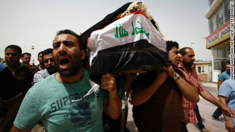 TOPSHOT - Iraqi men carry a coffin in the holy Iraqi city of Najaf on July 3, 2016, during a funeral procession for the victims of a suicide bombing that ripped through Baghdad's busy shopping district of Karrada. The blast hit the Karrada district early in the day as the area was packed with shoppers ahead of this week's holiday marking the end of the Muslim fasting month of Ramadan, killing at least 75 people in the deadliest single attack this year in Iraq's capital.     / AFP / Haidar HAMDANI        (Photo credit should read HAIDAR HAMDANI/AFP/Getty Images)