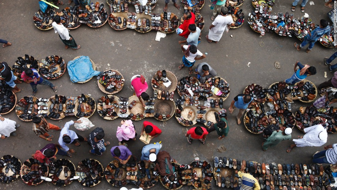 Shoe sellers display their wares in Dhaka, Bangladesh, on Monday, July 4. Traders expect to see good business at the end of Ramadan and the subsequent Eid celebration.