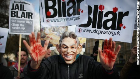 A Stop the War Coalition protester, wearing a mask depicting Former Prime Minister Tony Blair, shows bloodied hands on January 29, 2015 in London, England.