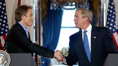 US President George W. Bush shakes hands with British Prime Minister Tony Blair in the Cross Hall of the White House during a press conference 17 July, 2003, in Washington, DC. The Iraq war allies are facing mounting criticism from both their countries over bad intelligence before the war. Blair maintained the accuracy of British intelligence on Iraq's purchase of nuclear material from Niger, saying 'we know for sure' that it bought 270 tons of the material from the African country in the 1980s