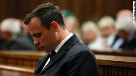 PRETORIA, SOUTH AFRICA - JULY 6: Paralympian athlete Oscar Pistorius (L), accused of the murder of his girlfriend Reeva Steenkamp three years ago, looks on during a hearing in his murder trial on July 6, 2016 at the High Court in Pretoria, South Africa.  (Photo by Marco Longari - Pool/Getty Images)