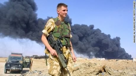 (FILES) This file photo taken on July 29, 2003 shows a British soldier at the scene of a burning oil pipeline, a few kilometres southeast of Basra, Iraq. The Chilcot inquiry into Britain's role in the Iraq war reports on Wednesday nearly seven years after it was launched. It is expected to deal extensively with the failures in the military operation, from the planning of the war to the occupation, after which Iraq descended into sectarian violence from which it has yet to emerge. / AFP PHOTO / AHMAD AL-RUBAYEAHMAD AL-RUBAYE/AFP/Getty Images