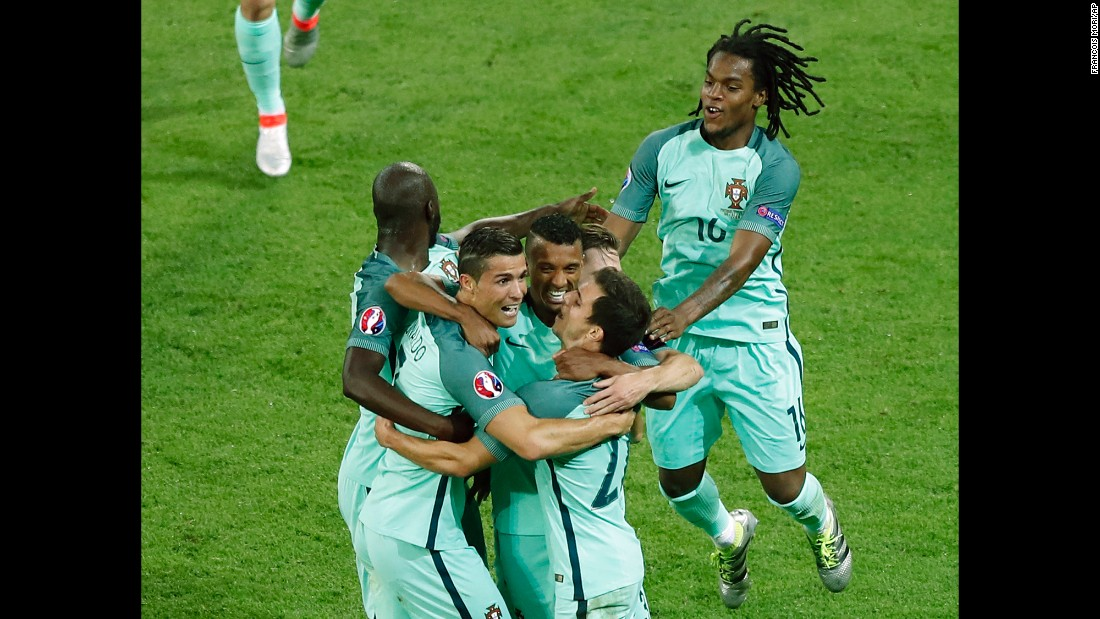 Portuguese players celebrate their second goal, which was scored by Nani in the 53rd minute.