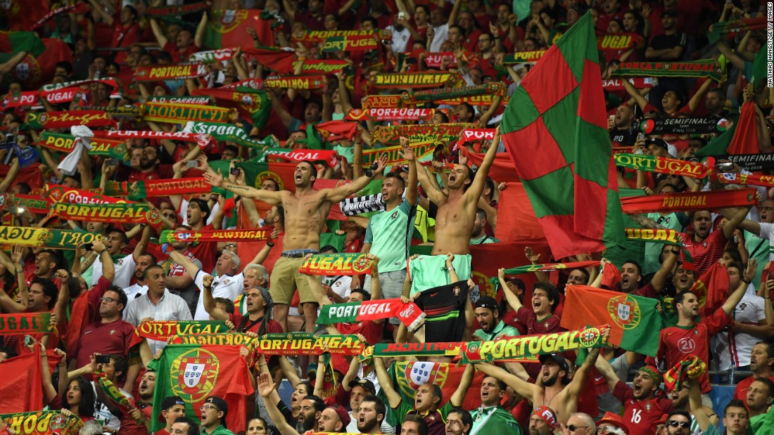 Portugal's supporters cheer their team after the second goal.