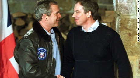 THURMONT, UNITED STATES: (FILES) -- File picture dated 23 February 2001 shows British Prime Minister Tony Blair (R) shaking hands with US President George W. Bush after a joint press conference in Thurmont, Maryland, down the road from the presidential retreat Camp David. Blair announced 10 May 2007 his resignation after a decade in powerr, saying he will stand down at the end of June. He told party suporters in his constituency of Sedgefield that he would step down as Labour leader, and therefore as prime minister on June 27.  AFP PHOTO/MARIO TAMA (Photo credit should read MARIO TAMA/AFP/Getty Images)
