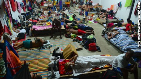 Cuban migrants rest in a shelter in the Turbo municipality, Antioquia department, Colombia, on June 14, 2016.   More tan 500 Cuban migrants are in Panama after the borders to Colombia were closed on May 9 to stop the flow of mainly Cuban migrants trying to reach the United States. / AFP / RAUL ARBOLEDA        (Photo credit should read RAUL ARBOLEDA/AFP/Getty Images)