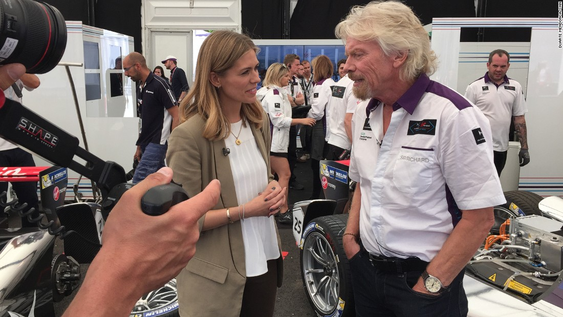 Richard Branson talks to CNN Supercharged presenter Nicki Shields in the DS Virgin Racing pit garage.