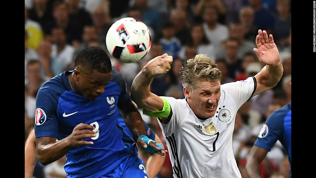 The penalty was awarded after Germany's Bastian Schweinsteiger, right, handled the ball in the box.